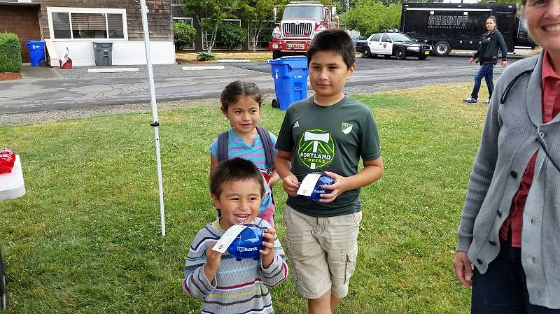 COURTESY PHOTO - The fundraising effort for the Cornelius library development has reached far and wide, with local children turning in the change from their piggy banks.