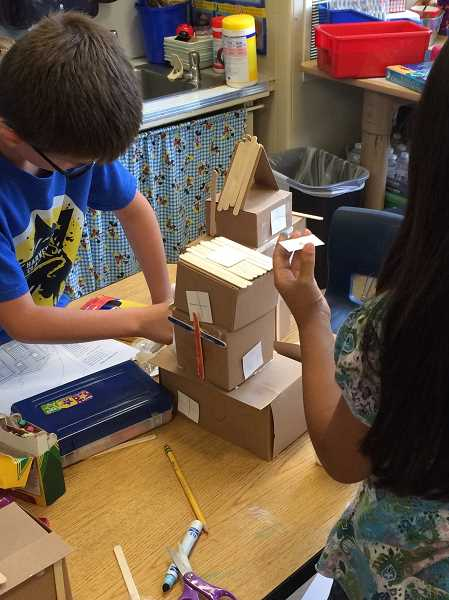 COURTESY PHOTO - Harvey Clarke first-graders powered down their electronic devices last year and got creative with history and homebuilding.