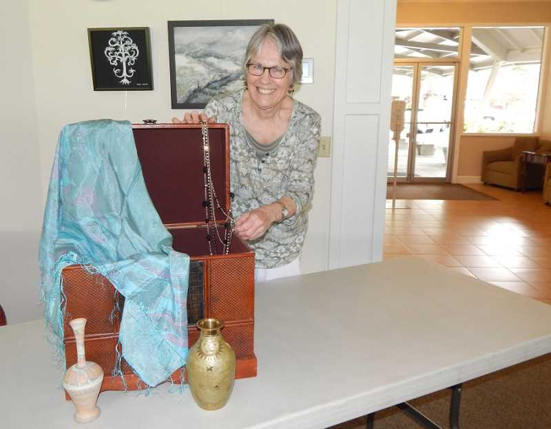 BARBARA SHERMAN - Valerie Schuyler, chair of the King City Civic Association's Aquatic Center fundraising efforts, shows some of the items that will be up for grabs in the Small Treasures sale in June.