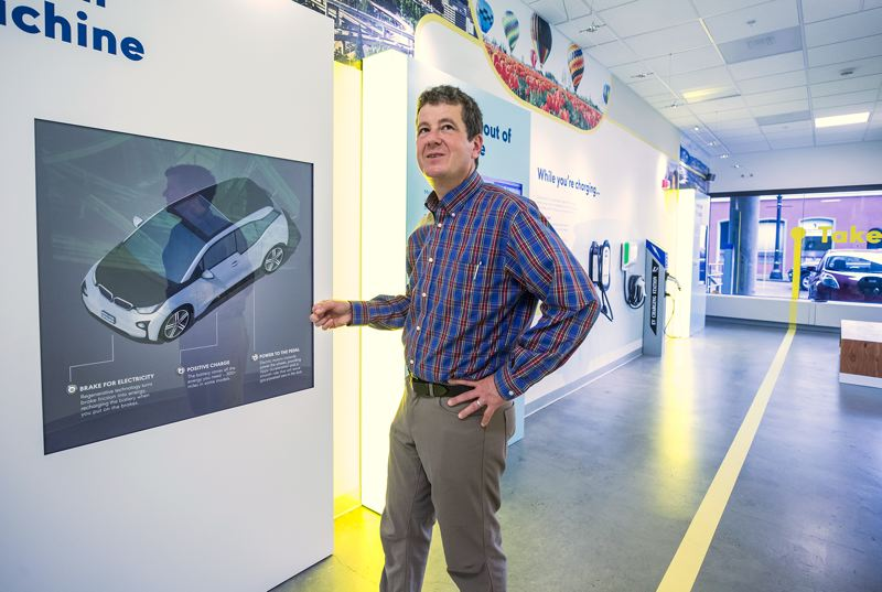 PORTLAND TRIBUNE: JONATHAN HOUSE - Jeff Allen shows how an electric vehicle works at an interactive display in his organization's new EV showroom in downtown Portland.