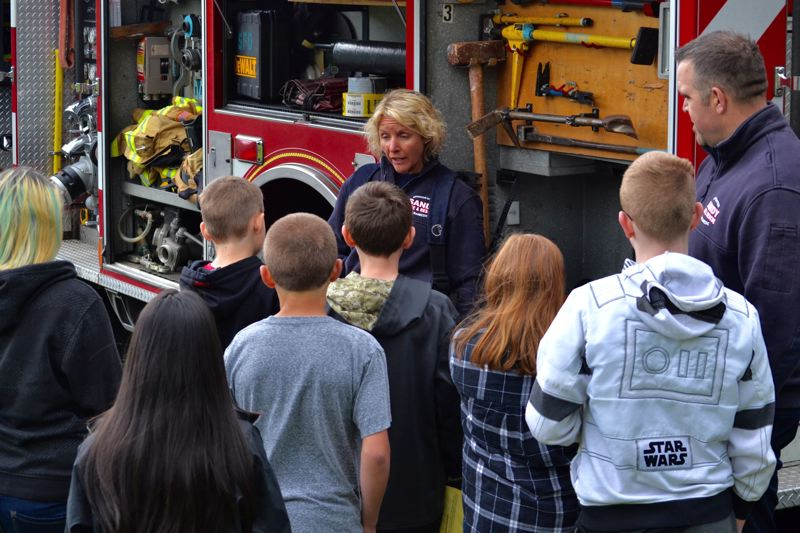 POST PHOTO: BRITTANY ALLEN - Laurie Smallwood from the Sandy Fire Department explains equipment to a group of eager middle schoolers.