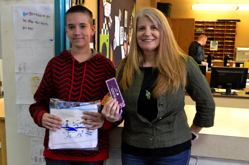 POST PHOTO: BRITTANY ALLEN - Jeannine Hokanson raffled off a miniature robot kit in her presentation on computer technology. Eighth-grader Luke Thompson was the lucky winner.