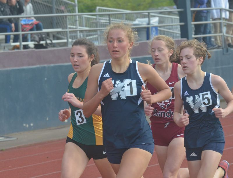 SPOKESMAN PHOTO: COREY BUCHANAN - Wilsonville freshman Samantha Prusse qualified for state in two individual events and one relay event at the district meet Friday, May 12 at Hare Field.