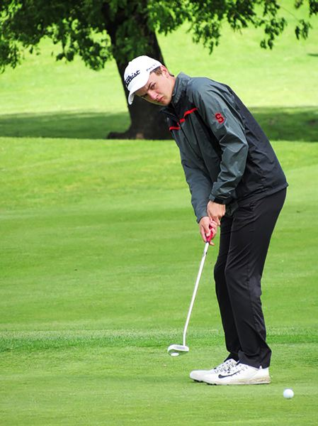 PHOTO CREDIT: BRENDA LOHMAN - Indians senior AJ Miltich follows through on a putt.