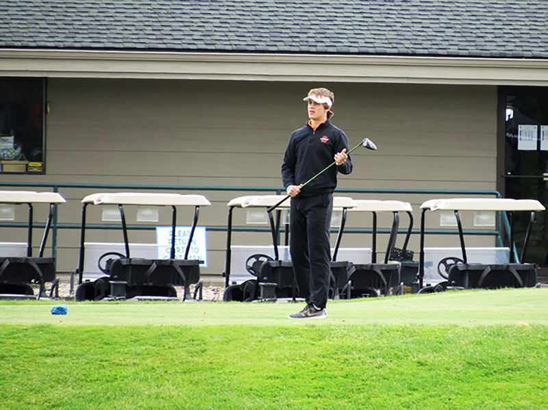 PHOTO CREDIT: BRENDA LOHMAN - Indians junior Jack Eggers watches a shot in flight.