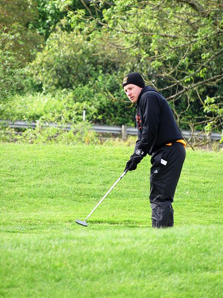 PHOTO CREDIT: BRENDA LOHMAN - Indians senior Colton Bush addresses a putt.