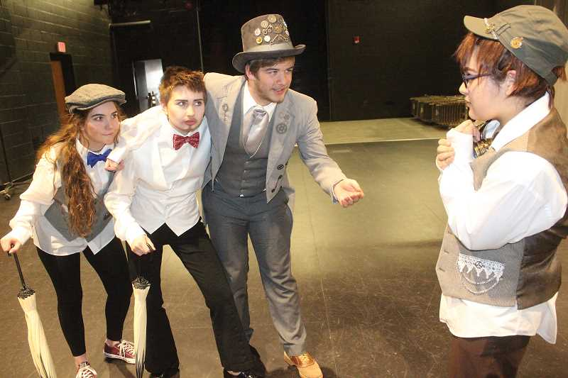 SUSAN MATHENY - Vineyard, at center, portrayed the Artful Dodger in the MHS spring musical, 'Oliver Twist,' which included drama club members.
