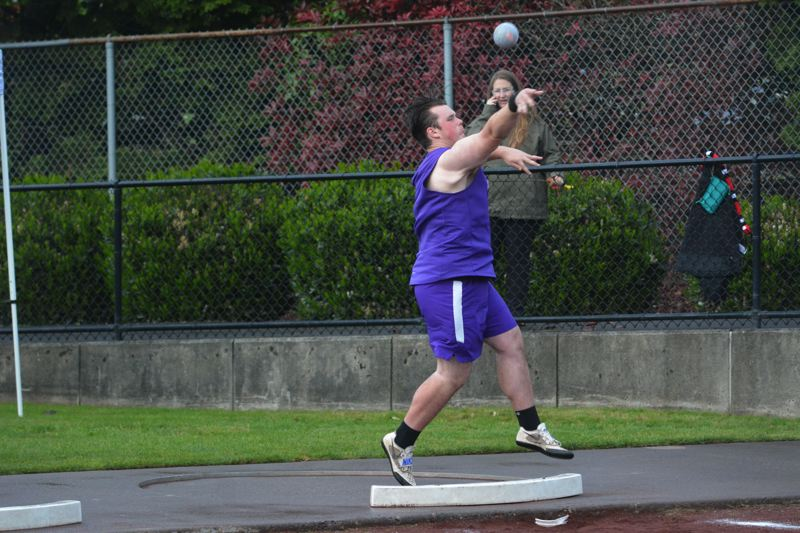 TIMES PHOTO: MATT SINGLEDECKER - Sunset thrower Karsten Collins claimed Metro League district titles in the shot put and discus.