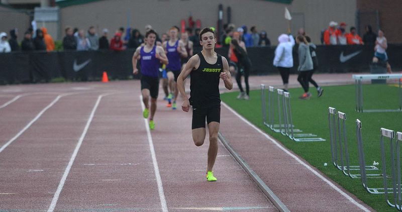 TIMES PHOTO: MATT SINGLEDECKER - Jesuit sophomore Josh Schumacher swept both the 1,500 and 3,000 meters at the Metro League district championship meet.