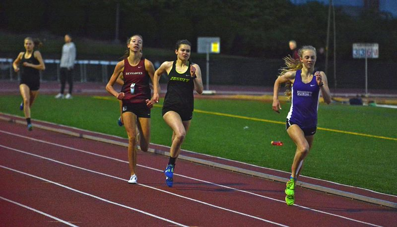 TIMES PHOTO: MATT SINGLEDECKER - Jesuit senior Chloe Jensen and the Crusader girls track and field team won the Metro League district title last week.