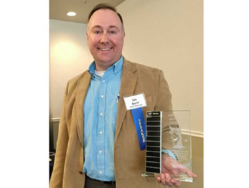 SUBMITTED PHOTO - Madras City Administrator Gus Burril won the first City Club of Central Oregon's 'Amazing Alpaca' award at regional forum.