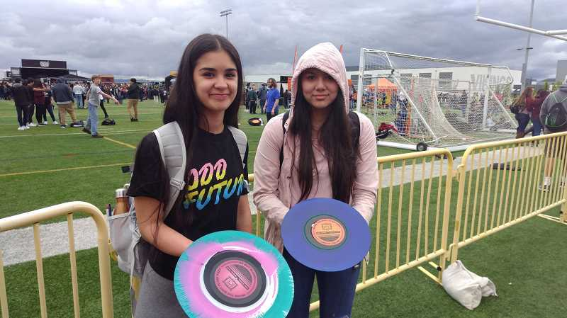 NEWS-TIMES PHOTO: STEPHANIE HAUGEN - Freshman Maria Gutierrez (left) and Vanessa Moreno made their own painted records Wednesday.