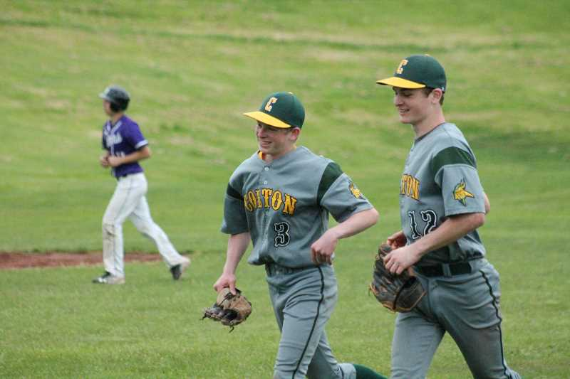 PIONEER PHOTO: CONNER WILLIAMS  - Colton sophomore TJ Tiano (left) and junior Dawson Hall jog off the field after Hall successfully turned a double play with junior Evan Rasor to end the inning during the Vikings' 10-0 win over Jefferson Tuesday to keep their playoff hopes alive.