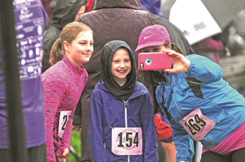 REVIEW PHOTO: VERN UYETAKE - Lake Oswego Schools Foundation Executive Director Mary Kay Larson snaps a quick selfie with Megan Larson (left) and Taylor Forseth before the start of Saturdays 5K Lake Run. The race is a Mothers Day tradition for the Larsons, who have now participated for nine consecutive years.