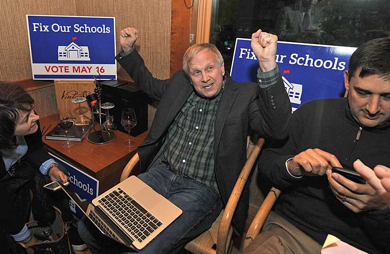 REVIEW PHOTO:VERN UYETAKE - School Board member John Wallin celebrates Tuesday night after voters overwhelmingly said 'Yes' to the school district's $187 million bond measure. Latest results show Measure 3-515 winning easily, 60.2 percent to 39.8 percent.