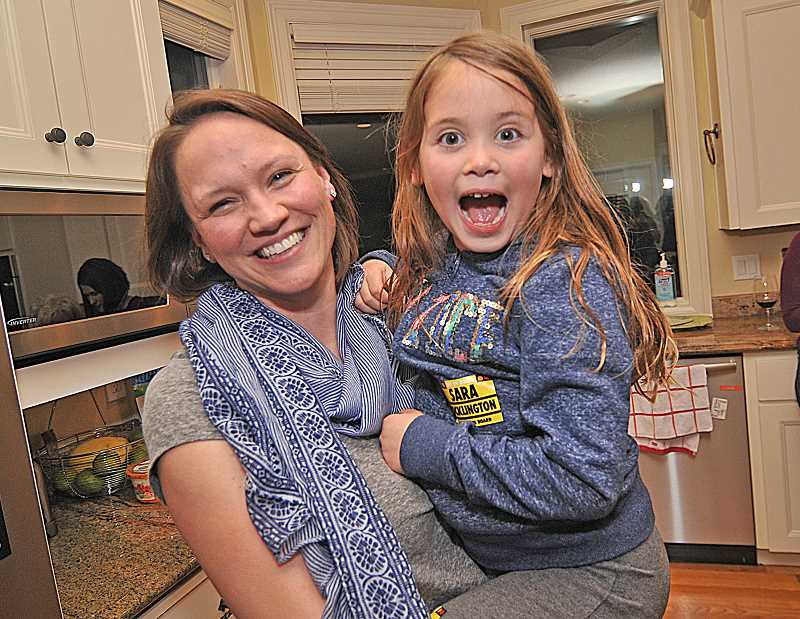 REVIEW PHOTO: VERN UYETAKE - Sara Pocklington celebrates with one of her biggest supporters, daughter Ava, after taking a commanding lead Tuesday night in the race for School Board Position 3. That early lead continued to hold up Wednesday, giving Pocklington 56.3 percent of the vote.