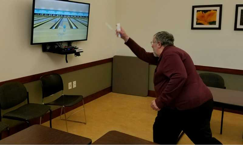 SUBMITTED PHOTO - WLACC member Mark Thomas encourages all to take part in Wii bowling, a new activitiy planned for 1 p.m. Tuesdays. Join the fun.
