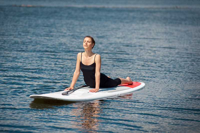 SUBMITTED PHOTO  - Try SUP (Stand-Up Paddle) Yoga through Lake Oswego Parks & Recreation.