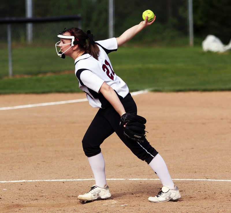 DAN BROOD - Tualatin junior Megan Woodward gets ready to fire in a pitch during the Wolves' win at Sherwood.
