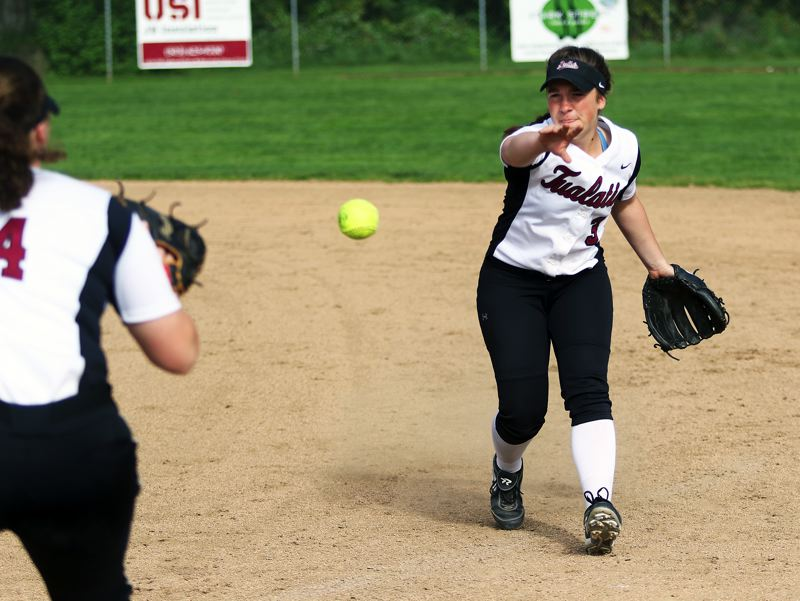 DAN BROOD - Tualatin senior second baseman Amanda Reser mades a backhand toss to first base in the win at Sherwood.