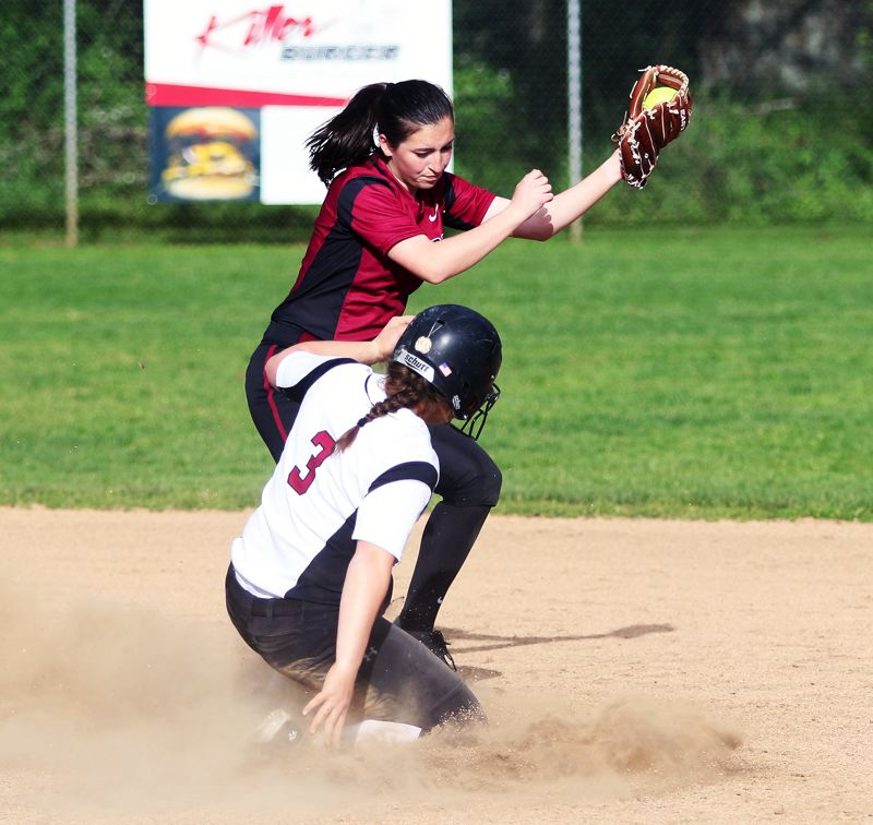 DAN BROOD - Tualatin senior Amanda Reser (3) slides to second base as Sherwood freshman shortstop Emily Knott looks to make a tag.