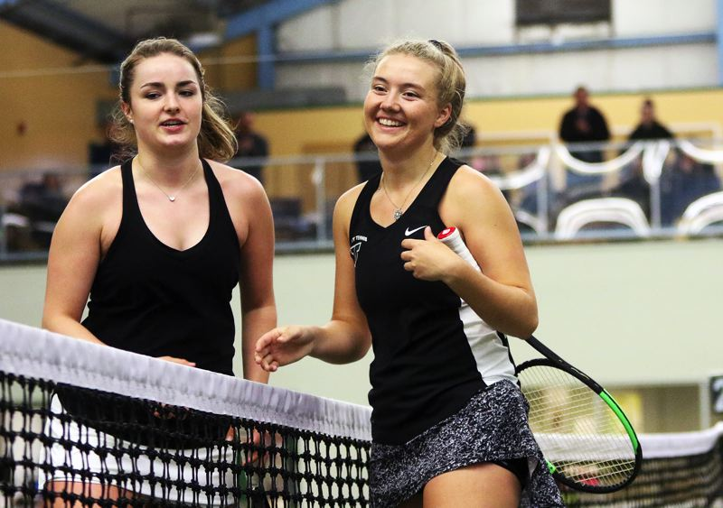 DAN BROOD - Tigard freshman Lizzy Stevens (right) greets Lakeridge junior Lily Stephens at the net following her win in the TRL girls singles title match.