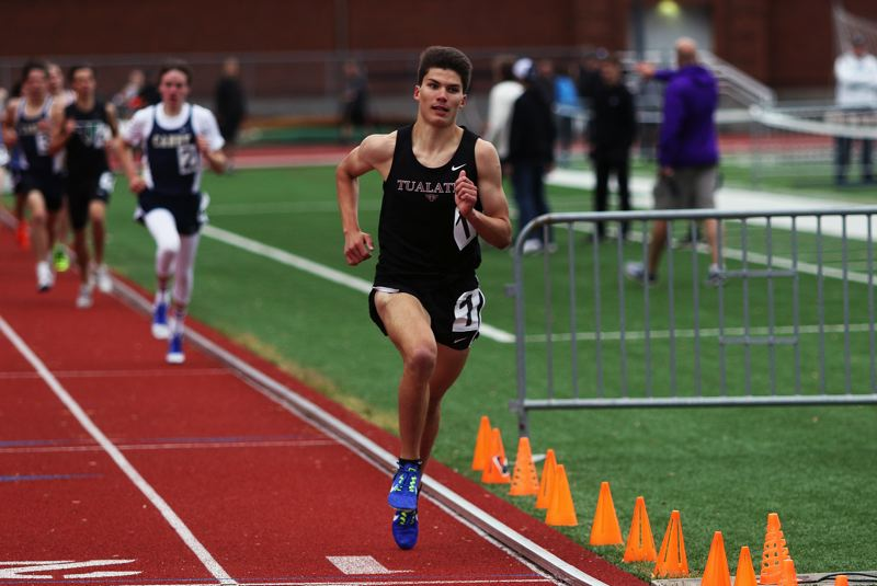 DAN BROOD - Tualatin High School junior Adam Klein is way out in front in the 1,500 at the Three Rivers League district meet. Klein won both the 1,500 and the 3,000. He'll be competing at the Class 6A state meet this week.