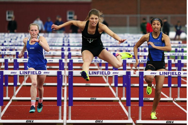 DAN BROOD - Tigard High School senior Sareena Patzke (center) is on her way to victory in the 100-meter high hurdles event at the Three Rivers League district meet. Patzke also triumphed in the long jump.