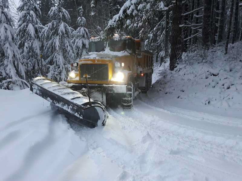 COLUMBIA COUNTY ROADS DEPARTMENT PHOTO - A truck equipped with a plow makes its way along roads in Columbia County after the region got roughly a foot of snow in January. The county estimated about $670,000 worth of damage from the snow storm.