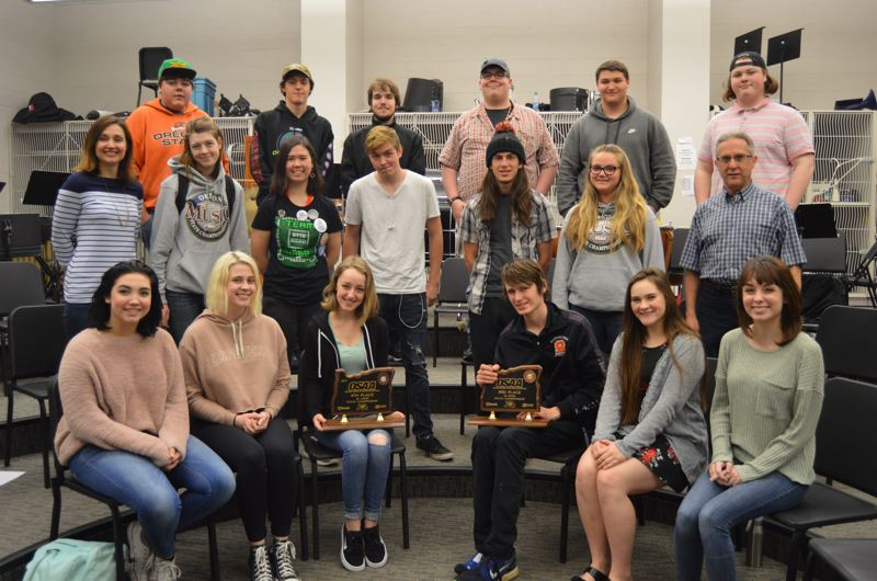 SPOTLIGHT PHOTO: NICOLE THILL - Pictured are some of the seniors from the Scappoose High School band and choir holding trophies they earned at their respective competitions.