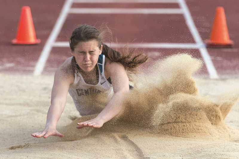 HILLSBORO TRIBUNE PHOTO: CHRISTOPHER OERTELL - Century's Courtney Buckley long jumps during last week's Metro League track and field championships at Jesuit High School.