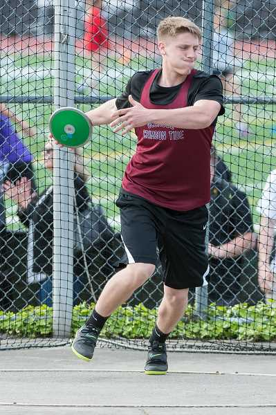 HILLSBORO TRIBUNE PHOTO: CHRISTOPHER OERTELL - Glencoe's Tucker Graser competes in the discus during last week's Metro League track and field championships at Jesuit High.