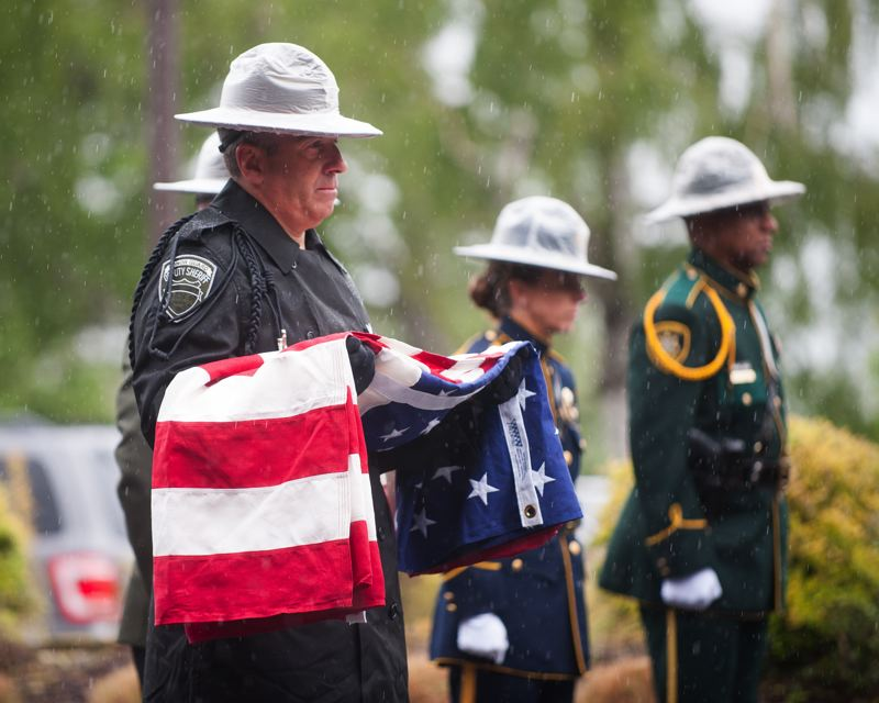 OUTLOOK PHOTO: JOSH KULLA - An honor guard parades the colors last Thursday, May 11, at the Multnomah County Sheriff's Office Troutdale facility, part of an annual memorial service for fallen officers.