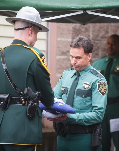 OUTLOOK PHOTO: JOSH KULLA - Multnomah County Sheriff Sheriff Mike Reese accepts the colors May 11 as part of the agency's annual commemoration of fallen officers.