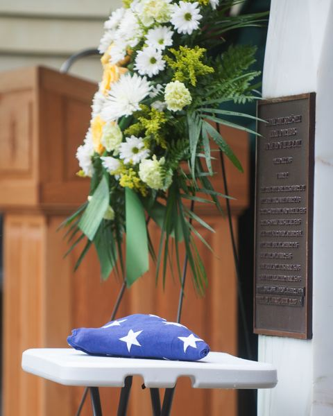 OUTLOOK PHOTO: JOSH KULLA - The folded American flag sits next to a plaque listing the names of Multnomah County Sheriff's Deputies killed in the line of duty.