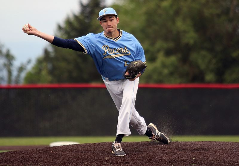 PMG PHOTO: JIM BESEDA - Lakeridge's Josh Robins delivers a pitch during his team's 5-2 loss to Oregon City at Clackamas High School in Wednesday's Class 6A Play-In game.