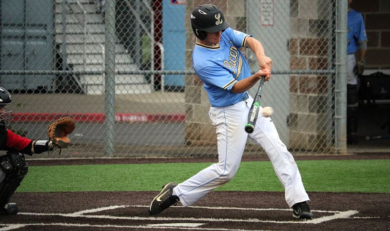 PMG PHOTO: JIM BESEDA - Lakeridge's Everest Webster doubles in two runs during his team's 5-2 loss to Oregon City at Clackamas High School in Wednesday's Class 6A Play-In game.
