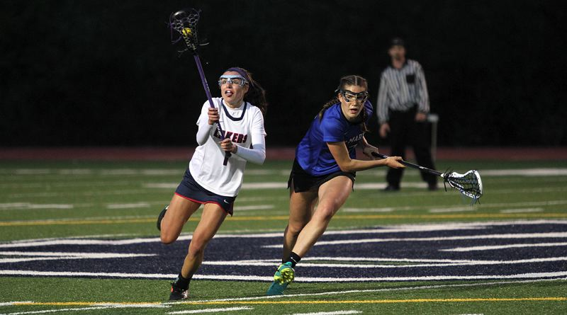 REVIEW PHOTO: MILES VANCE - Lake Oswego's Lauren Gilbert snares a loose ball during her team's 21-8 victory over St. Mary's in the quarterfinals of the OGLA state quarterfinals at Lake Oswego High School on Wednesday.