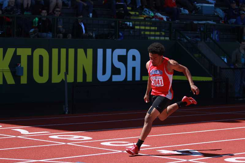 PHIL HAWKINS - Mitchell's time of 11.13 in the 100-meter prelims was a new PR for the Kennedy senior.