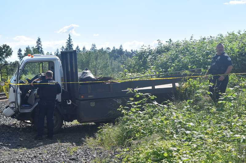 DANIEL PEARSON - The truck came to rest on the railroad tracks just south of downtown Canby.