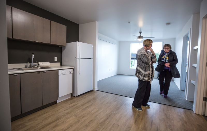 PORTLAND TRIBUNE: JONATHAN HOUSE - Grand opening attendees check out a one-bedroom unit at the new affordable St. Francis Park Apartments. Rents range from $369 to $766 a month, depending on size and location.
