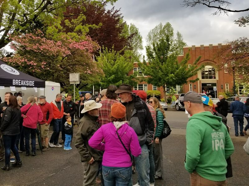 PHOTO BY NIKKI WEST - Milwaukie Mayor Mark Gamba chats with people enjoying the First Friday event along Main Street.