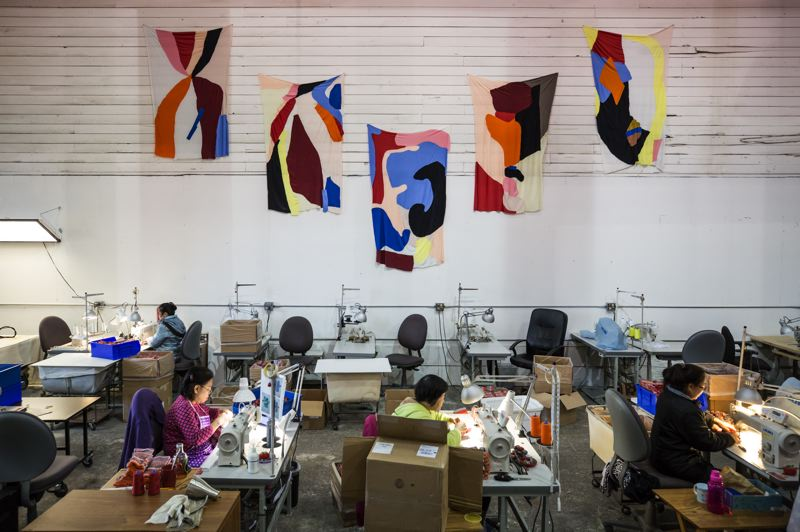 PAMPLIN MEDIA GROUP: JONATHAN HOUSE - Five flags represent the five core values of the Portland Garment Factory, which employs all women, half of whom are immigrants. The values are:  Respect Time, Think Forward, Honor Process, Invite Challenge and Be Human.
