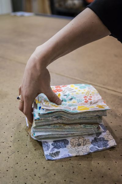 PAMPLIN MEDIA GROUP: JONATHAN HOUSE - Portland Garment Factory is a zero waste business, meaning everything that can be recycled is. The fabric squares will go to the sewing group at the Coffee Creek correctional facility.
