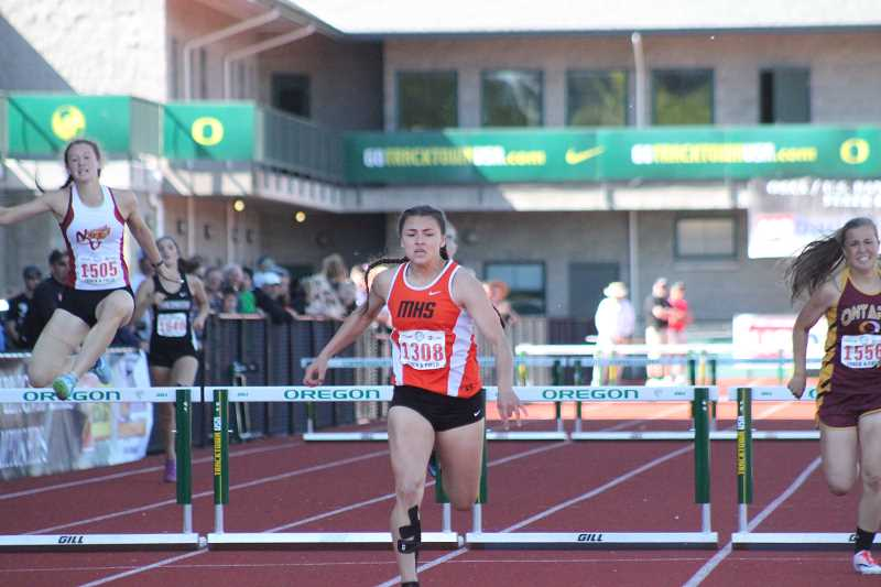 PIONEER PHOTO: CONNER WILLIAMS - Molalla senior Desirae DesRosiers crosses the finish line to repeat as Class 4A state champion in the 300m intermediate hurdles Saturday at the OSAA State Track & Field Championships at Hayward Field.