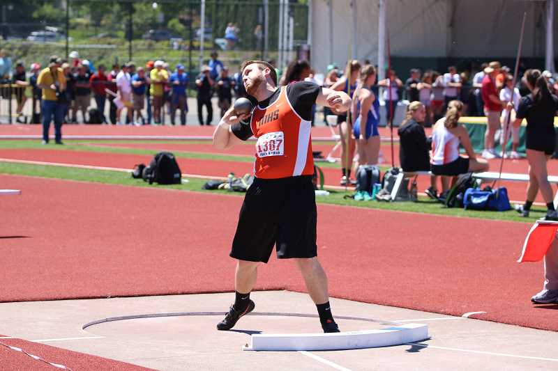 PAMPLIN MEDIA GROUP PHOTO: JIM BESEDA - Molalla senior Mont Child winds up to throw the shot put at the state meet Friday. Child defended his title in the event, throwing a personal record 55 feet, one inch.