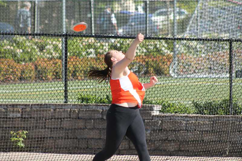 PIONEER PHOTO: CONNER WILLIAMS - Molalla senior Rachel Bring launches her discus at the state meet Saturday. Bring defended her title in the event, throwing a personal record 148 feet, nine inches.