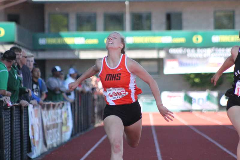 PIONEER PHOTO: CONNER WILLIAMS - Country Christian junior Anna Farner crosses the finish line in the 200 meter dash at the state meet Saturday. Farner took sixth in the event with a PR time of 26.53 seconds.