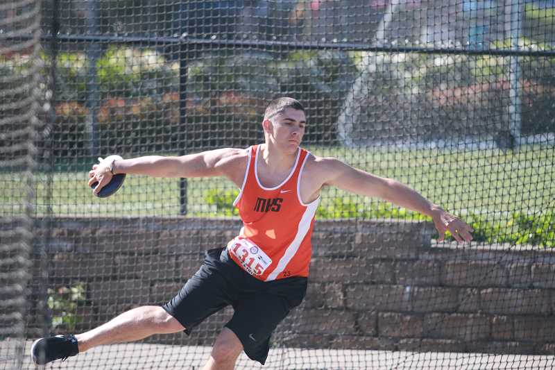 PAMPLIN MEDIA GROUP PHOTO: PHIL HAWKINS  - Molalla senior Berkely Olsen winds up to throw his discus at the state meet Friday.