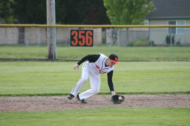 PIONEER PHOTO: CONNER WILLIAMS  - Molalla sophomore Jeff Larsen fields a ground ball during the Indians' play-in game against Junction City last Thursday.
